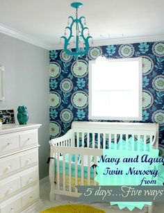 plan a nursery around a graphic, colorful wallpaper.  even if you just use it for one accent wall.