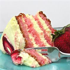 """Strawberry Lemonade Layer Cake -  One box of strawberry cake mixed as directed and baked in 2 9"""" pans. When cool, mix 8oz. Philadelphia Cream Cheese + 1 packet (0.23oz.) of Kool-Aid Lemonade  + Yellow food coloring gel. Stir in 2c Marshmallow Creme  + 8 oz. Cool Whip. Garnish with Fresh strawberries."""