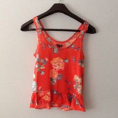 AE Flowered Tank Size M Gorgeous, bright, and soft- this tank is summer perfect! Depending on your torso, there may be a slight crop to it. Ruffled bottom hemline. Rounded front and back neckline. Feels like the softness of the inside of a sweatshirt. American Eagle Outfitters Tops Tank Tops