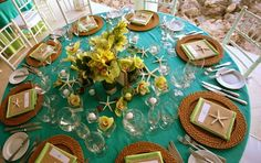 Perfect beach wedding tablescape! Use an aquamarine linen and yellow flowers to recreate this look!