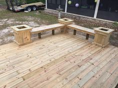 440 square foot deck with power outlets on each side. Planter boxes and benches on the corners.