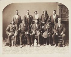 """Sioux Delegation - (Oglala Sioux) men identified as: (standing l to r) """"Man Like a Bear, Brother of All, Bowed Head, Jumping Thunder, Rupacokanmaza (sitting l to r) Medicine Bull, Charger, Strike the Ree, Good Last Born, [unidentified]."""""""
