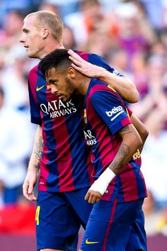 Neymar of FC Barcelona celebrates with his team-mate Jeremy Mathieu of FC Barcelona after scoring the opening goal during the La Liga match between FC Barcelona and Granada CF at Camp Nou on September 27, 2014 in Barcelona, Catalonia.