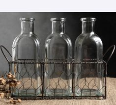 Inexpensive set of vintage-look bottles in wire basket!  Great for home decor or wedding/event centerpieces.  Use vintage labels (free downloads from Graphics Fairy), perhaps incorporating the couple's monogram.  Use alone, or as bud vases to get more bang out of the flower budget.  Surround with other vintage items, such as photo frames, scattered buttons, etc. depending on theme of event.