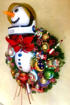 """""""Houston, we have a snowman.""""  Wreath made by Kirstin Mayberry/Kiriosities for Jet Propulsion Laboratory/Caltech."""