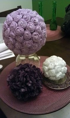 paper flower centerpieces - easy to make and cheap! rose ones are made from streamers, and the hydragena-looking one is made from tissue paper