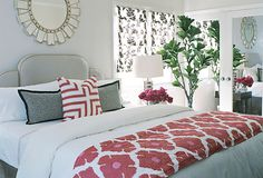 White bedding with fun quilt and pillows