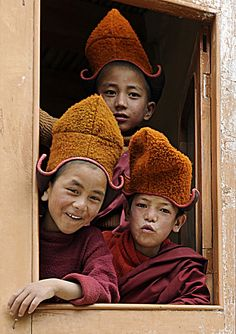 Paul Bulteel: This photo of playful pupil buddhist monks was taken at the Stongdey monastery in the isolated Zanskar valley of Northern India.The valley can only be reached by a 250 km one way track starting from Kargil at the Chinese border. During the winters this road is closed for several months & access is only possible by trekking over the frozen rivers - or by helicopter in case of an emergency.The Zanskar region together with neighboring Ladakh is a stronghold of Tibetan buddhism.