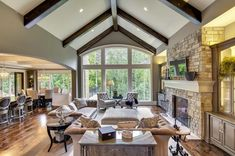 LOVE THIS. like the high ceiling and the way the kitchen/dining are more side by side with the living room next to them. Love the window