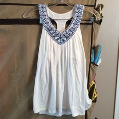 Victoria's Secret White Embroidered Racerback Tank Victoria's Secret White Racerback tank with blue embroidery design. Built in shelf bra. Lightweight, great for summer. Has sort of a Native American motif in the embroidery. Size Medium Victoria's Secret Tops Tank Tops