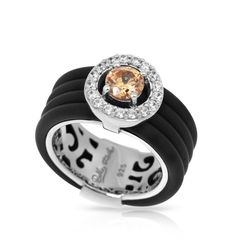 Circa Collection; Black & Champagne Ring; A must have addition to any wardrobe. In chic brown or black Italian rubber, adorned with luminous color stones and circled by twinkling pavé-set stones, this marvelous collection acts as the perfect accent. Be charmed.