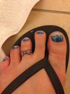 Bow toe ring tattoo