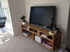 Old Pallet TV Stand | pallet wood tv stand with hairpin legs in living room
