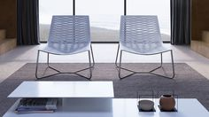 The ultimate in designer seating, this art piece lounger promises the best of relaxation and reinvigoration. Complex laser cut detailing engages the eye while revealing an brilliant design element: just a single piece of leather comprises the leather seat. A carbon steel tube frame completes the luxe look.