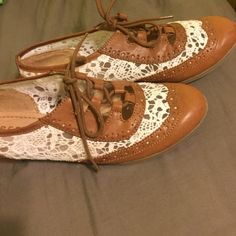 Brown and white lace shoes Worn only once these shoes are stylish and comfortable! Report Shoes Flats & Loafers