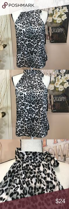 "Leopard Print Self Tie Neckline Blouse How pretty is this cute leopard print top with self tie bow and cut away shoulders. Sleeveless.  Pair it with a fabulous pair of slacks and you're good to go anywhere. Chest across is 19"", length from top of Collar to bottom is 25.5"". 100% Polyester. Tops"
