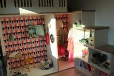 loft bed up above, two spaces below & a shelving unit staircase. Perfect kid's room!