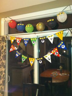 A Lego Ninjago inspired birthday banner that I made with Adobe Photohop Elements, and {Pinterest inspired} Ninjago paper lanterns- all made for my son's 5th birthday !