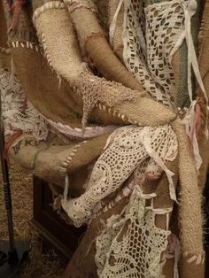 Burlap and lace curtain. LOVE this! Could make a few and use in the house after the wedding. Adorable!! Also, upcycle grandma's homemade doily's on it. :)