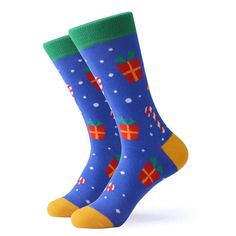 Get in the Holiday spirit with a pair of our Christmas present socks. For you or for a friend these funky Christmas socks feature candy canes, snowflakes, and presents on a blue background with yellow and green trim. Made with 80% Cotton, 17% Nylon, and 3% Spandex, these unisex socks are perfect for US Size 7.5-12.5 feet. Funky Socks, Blue Socks, Crazy Socks, Candy Canes, Blue Backgrounds, Christmas Presents, Snowflakes, Spirit, Spandex