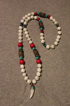 Necklace with White Turquoise beads, Turquoise Mala beads, turquoise & red wood beads, Yak Bone beads & a Tibetan Tooth Amulet.