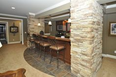 Basement bar Nice way to cover ugly support poles - add shelving to pillars to make it into a dry bar