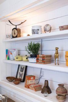 trinkets wood display white café interior