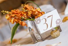 orange wedding reception table numbers