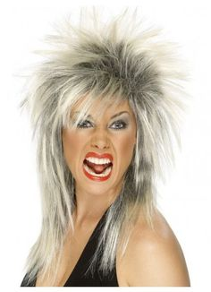 Rock Diva (Tina Turner) 80's Blonde and Black Costume Wig Rock Diva (Tina Turner) Costume Wig. Two Tone, Blonde & Black, Long Mullet. Perfect for your 1980's punk rocker costume theme.  You will love how you look and feel wearing this quality costume wig. www.thewigoutlet.com.au