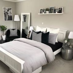 Luxury grey bedroom inspiration, grey and white modern bedroom with picture shelf styling and bedside tables, a reading corner and pillar candlesticks. White Bedroom Design, White Bedroom Decor, Home Decor Bedroom, Bedroom Chair, Bedroom Designs, Bedroom Ideas Grey, Modern Grey Bedroom, Small Grey Bedroom, Black White And Grey Bedroom