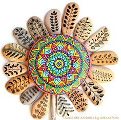Mini pebbles with my colorful mandala #paintedstones https://www.facebook.com/ISassiDelladriatico