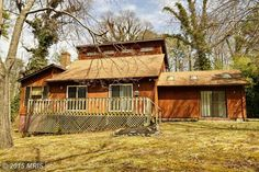 Excellent Value ! Stunning ... waterview contemp near  Patuxent River w/ beach access in quiet neighborhood  Main house (3 BR/2 BA) plus separate addition (2 BR + BA) w/private entrance.Huge great rm + FP, table space kitchen &DR (or den) off kitchen.3 BR (2 up), 2 BA (1 off MBR w/ jetted tub).MBR w/ deck plus deck off great rm. Interior freshly painted & new carpet main house!Great investment !