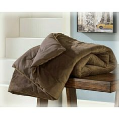 "Conner chocolate micro mink plush pile reversible machine washable throw blanket. Clearance Measures 50"" x 60"" SKU 	A1000035 Clearance"