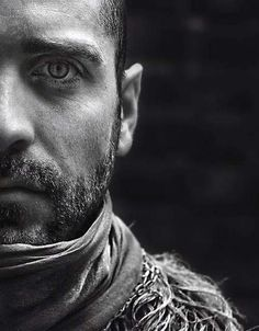 Gritty, lots of deep detail and emotion. Black and white half face shot just like this, farther crop maybe on a few