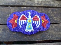 Check out this item in my Etsy shop https://www.etsy.com/listing/222935717/hand-beaded-native-american-thunderbird