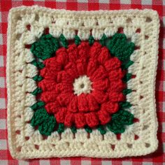 christmas square--this crafter's photostream contains a photo of her completed afghan made from a variety of holiday-inspired squares--it's a real beauty and worth checking out--can't be posted to Pinterest