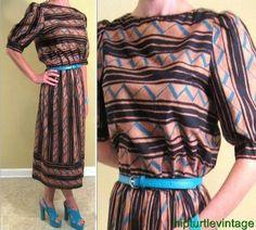 Vintage Aztec zigzag dress M L http://www.ebay.com/itm/Vtg-70s-80s-AZTEC-puffy-sleeveTRIBAL-Dress-ZIGZAG-button-back-NAVAJO-Ethnic-M-L-/200876608234?