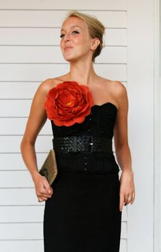 Love this little black dress with over sized flower by EmersonMade