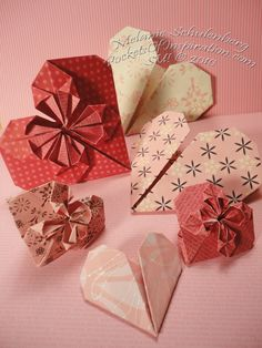 I'm getting ready to sharesome paper origami hearts I createdlast weekend. What I'm not going to share is the amount of time I spent on t...