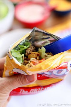 """Walking Tacos"" - crush up a baggie of Fritos, and dump in your favorite taco ingredients. This sounds PERFECT for a no-mess camping recipe!"