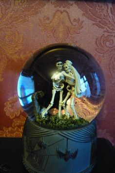 Close up without flash of my musical snow globe, with cute little skeletons.