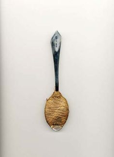 """Dangerous Beauty: The Art of the Shiv  Materials: Stainless steel tablespoon; handle wrapped with upholstery. Backstory: At its core here is a spoon, stolen from the staff dining room at Rahway, where, as in many federal penitentiaries, inmates were restricted to using plastic flatware. Stamped """"State of NJ,"""" the spoon likely to have been sharpened on the cement floor"""