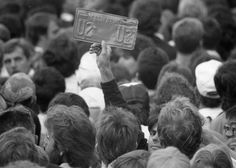 """Nov. 11, 1987: With just two hours notice, 20,000 people showed up in Justin Herman Plaza to watch U2's free """"Save the Yuppie"""" concert."""