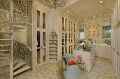 Lovely closet with spiral staircase and shelves!