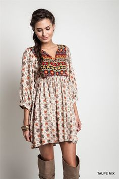 Comfortable cotton dress printed with traditional bohemian pattern goes well with the brown boots and healthy skin color. This casual yet elegant, wild yet feminine Boho style could be a representative of west village.