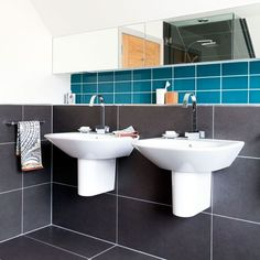 Like the twin sinks and big, dark tiles with light grouting.