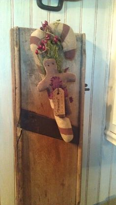 Use an old wooden slicer and decorate any way you want. Hang on kitchen wall.
