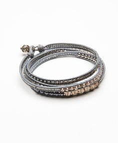 A constellation of glittering glass beads loops around your wrist to add instant glamour.
