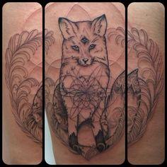Third-eye fox tattoo.