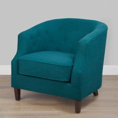 @Overstock - This sophisticated accent chair features peacock blue upholstery and button tufting for a classic appeal. Cappuccino-finished wooden legs complete this handsome chair.http://www.overstock.com/Home-Garden/Ansley-Peacock-Blue-Tub-Chair/7109314/product.html?CID=214117 $289.99